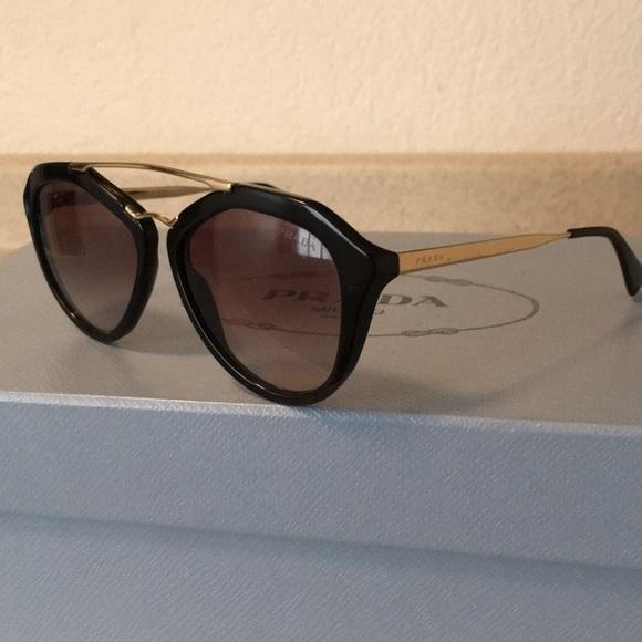 2f0edd1797d0 Prada Sunglasses with gold hardware. M 5b576ffed8a2c72db30110ea. Other  Accessories ...
